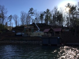 new home, sea wall, and boathouse